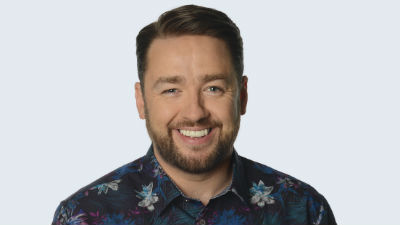 Comedian Jason Manford smiling towards the camera.