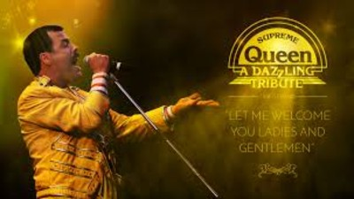 Scott Maley as Freddie Mercury in a yellow jacket and holding a microphone. Gold text to the right reads 'Supreme Queen, a Dazzling Tribute