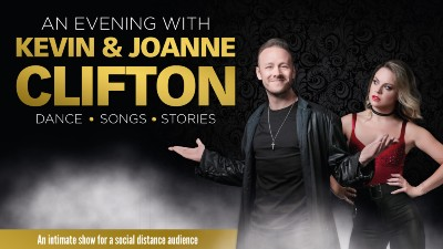 Dancer Kevin Clifton stands with his arms out in a shrug, behind him Joanne Clifton stands with her hands on her hips. Gold text to the left reads  AN EVENING WITH KEVIN AND JOANNE CLIFTON