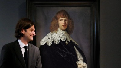 Dutch art dealer Jan Six stands in front of Rembrandts 'Portrait of a Gentleman'
